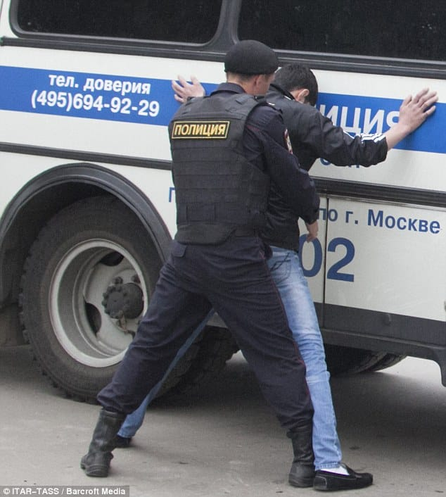 Chief of Russia's Gey Politsii Aleksi Chernobyl searches a bus rider for gayness.
